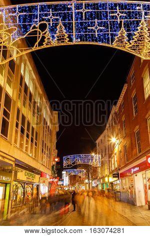 NOTTINGHAM ENGLAND - DECEMBER 22: People Christmas shopping Clumber Street Nottingham. In Nottingham England. On 22nd December 2016.