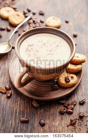 Coffee with milk and cookies. Food background