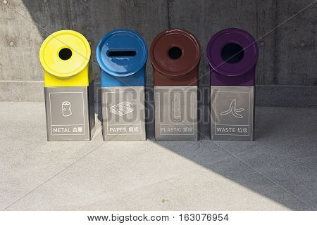 Modern bins for different types of garbage. Metal paper plastic and waste
