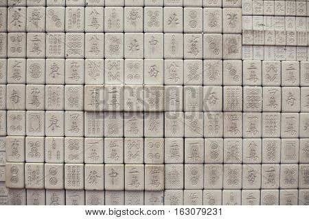 Wall of chinese characters on bricks. White background