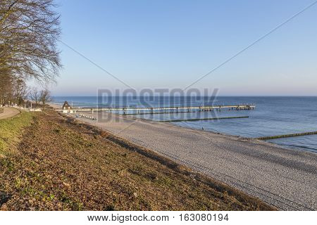Beach Landscape With Pier At Koserow