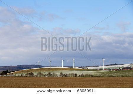 Wind Generators In Rural Landscape In Winter