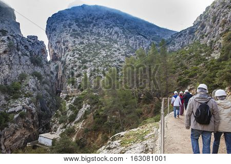 Visitors begining Caminito del Rey path Malaga Spain. Landscape with hills canyon full of morning mist
