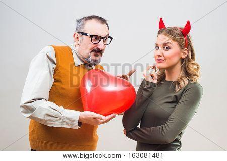 Nerdy man is uncertain in his girlfriend love.