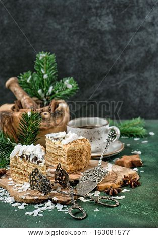 Honey cake with spices and Christmas decoration. Festive sweet food. Vintage style toned picture
