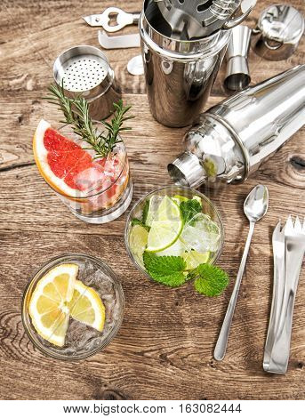 Cocktails with fruits and ice. Bar drink making tools. Holidays food and beverages