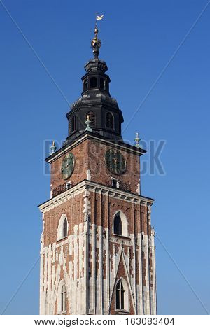 Town hall with clock in Krakow, Poland