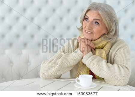 Portrait of a woman drinking coffee, thinking about something