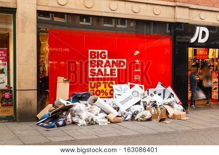 NOTTINGHAM ENGLAND - DECEMBER 26: Discarded Christmas POS outside JD Sports as Boxing Day sales start. In Nottingham England. On 26th December 2016.
