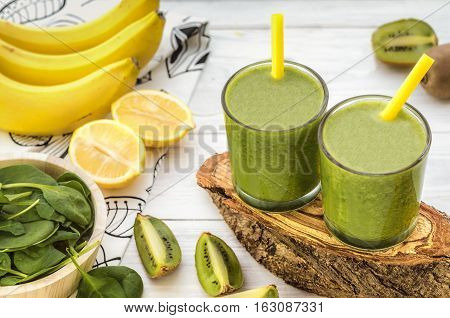 Fresh and healthy green smoothie with spinach,banana and kiwi. Vegetarian breakfasts. Picture with space for text or logos.