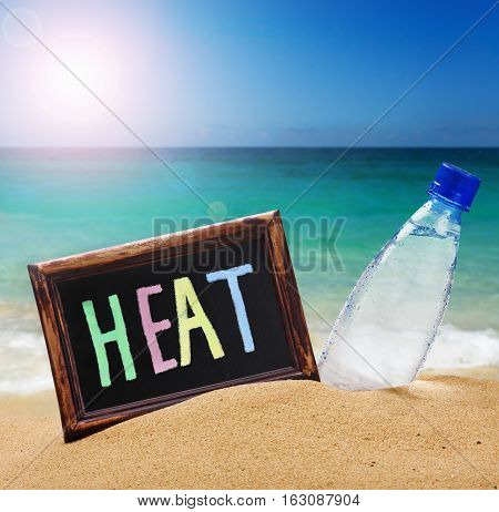 black board with the text of the heat and water bottle on the beach