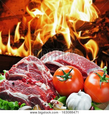roast beef meat slices with vegetables on the background of the grill