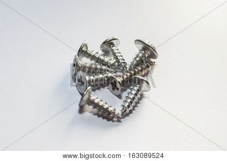 Used old screws with isolated white background for commercial
