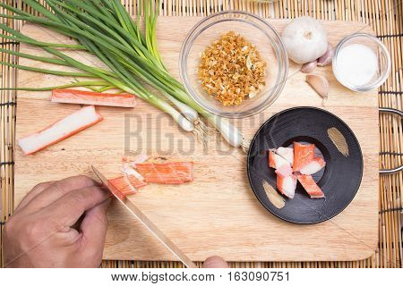 Chef cutting crab imitation / cooking fired rice concept