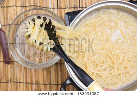 Spaghetti lifted on of cold water / cooking spicy spaghetti concept