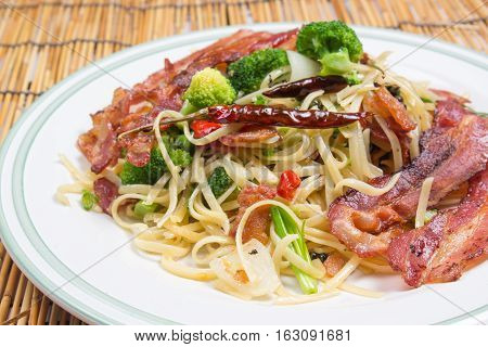 Spicy bacon spaghetti on the plate / cooking spicy spaghetti concept