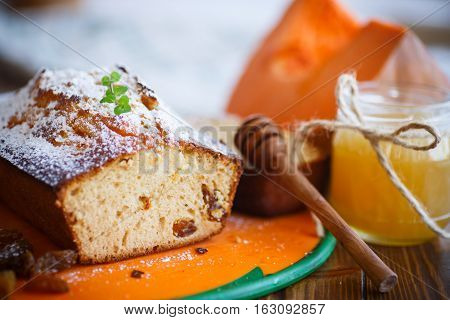 Sweet pumpkin muffins with honey and raisins