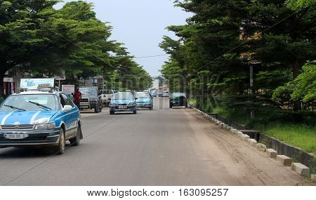 City roads view and colorful painted taxi cars in Pointe-Noire, Congo Republic, february 2015