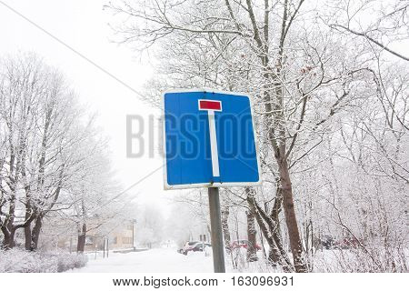 The Dead End Road Sign On Winter Sky And Trees Background.