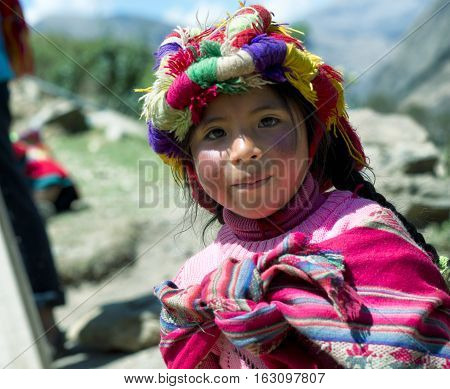 Portrait of a Peruvian girl dressed in colourful traditional handmade outfit. October 21 2012 - Patachancha Cuzco Peru