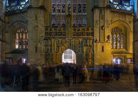 Congregants after Christmas Midnight Mass at Bath Abbey. Hundreds of people leave religious service celebrating Christmas through main doors of Anglican Cathedral