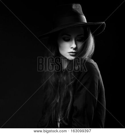Expressive Female Makeup Model Posing In Black Shirt And Elegant Hat On Dark Background And With Thi