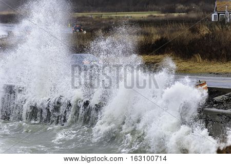 Powerful waves crash against retaining wall along Ocean Drive in Newport Rhode Island