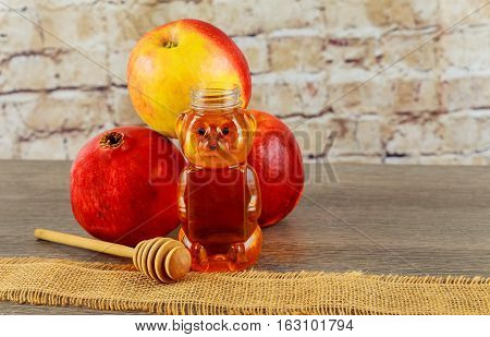 Jewish holiday jewish symbol Holiday symbo Jewish holiday Jewish new year. Rosh Hashana apples honey and pomegranates on a dark wood background traditional food for the Jewish new year. Rosh Hashana. selective focus on the middle of the honey