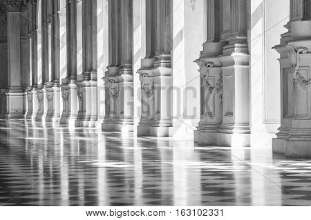 Black and white gallery in a beautiful palace with sunlight