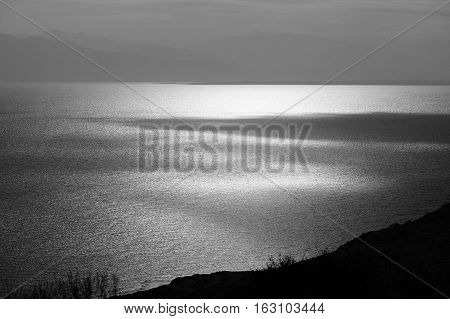 Light and shade on Dead Sea surface in black and white.