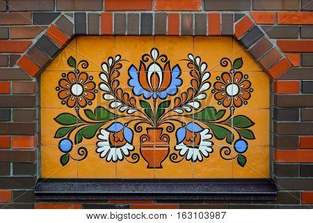 Ethnic ceramic decoration on the wall. Opishnya Poltavska oblast Ukraine.