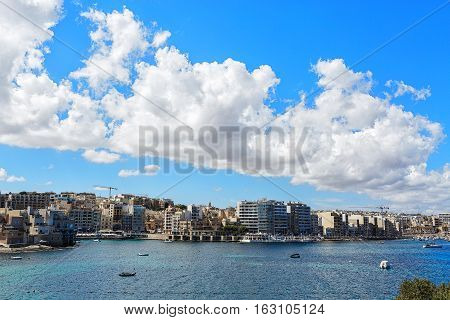 Malta city view with blue sea and cloudscape
