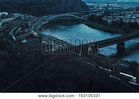 Usti nad Labem Ustecky kraj Czech republic - November 20 2016: evening cityscape with river elbe two bridges train and automobile traffic