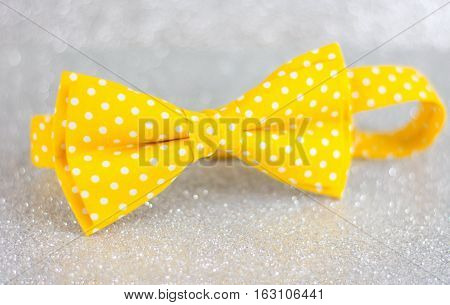 Yellow Bow Tie On Silver Background