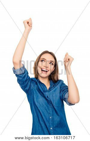 Excited Happy Young  Woman Triumphing With Raised Hands