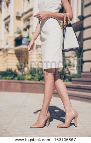 Close Up Of Modern Fashionable Woman In High Heel Shoes Walking On The Street