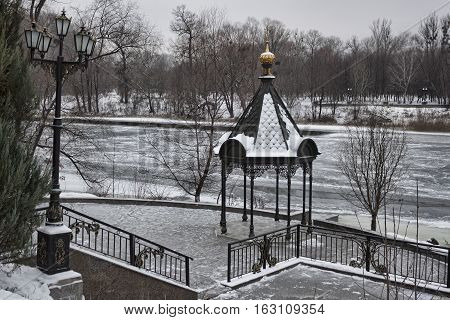 Siversky Donets River winter. Gazebo Chapel on the waterfront of Sviatohirsk Lavra