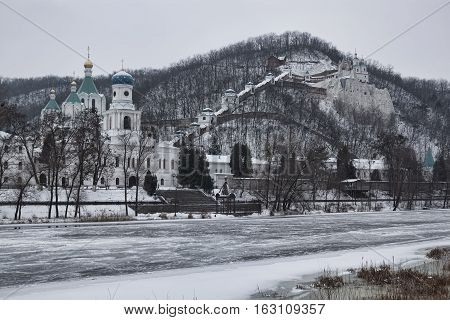 Siversky Donets River winter. On the opposite the Churches of Sviatohirsk Lavra