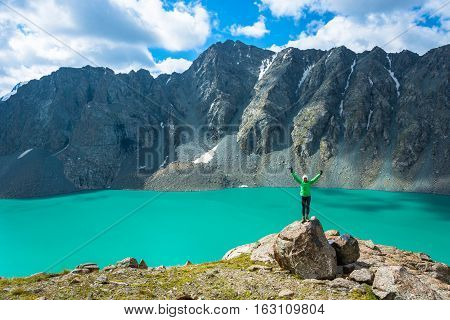A Woman Stands On A Huge Stone On The Background Of The Lake Ala-kul, Kyrgyzstan.