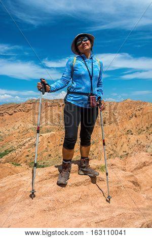 A Woman Standing On A Mountain Canyon Fairy Tale, Kyrgyzstan.