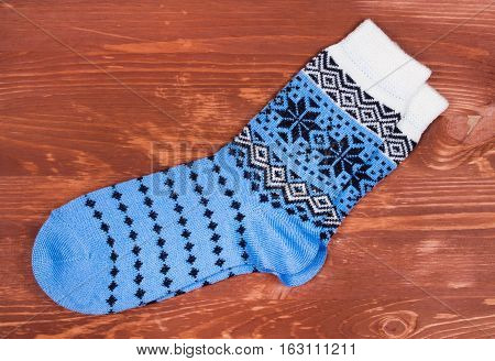 Pair of new socks on wood desk close up