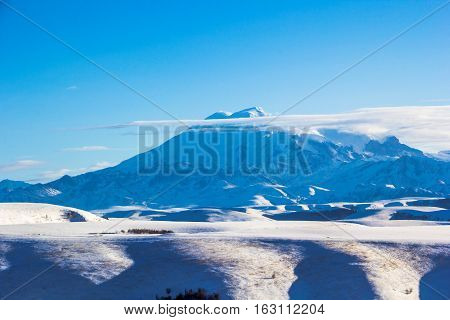 beautiful view of snow tops of Mount Elbrus, nature of the North Caucasus, winter landscape
