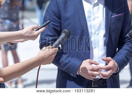 News conference. Media interview with businessman or politician.