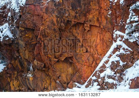 Wisconsin red granite rock with December snow.