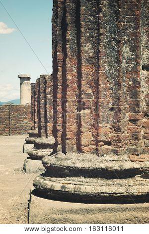 Ruined broken Roman column at Pompeii travel landscape