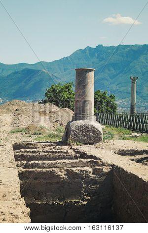 Ruined broken Roman column at Pompeii retro