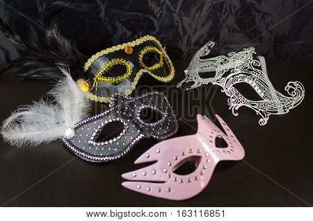 Erotic And Carnival Face Packs On A Black Table