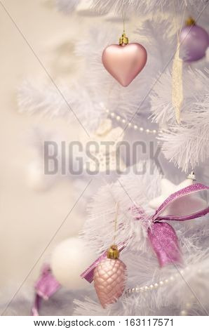 Soft pastel christmas tree decoration on a christmas fur-tree