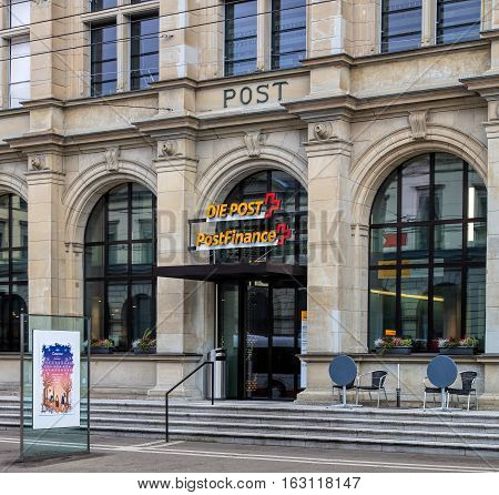 Winterthur, Switzerland - 26 December, 2016: entrance to the Swiss Post office on Bahnhofplatz square. Swiss Post is the national postal service of Switzerland.