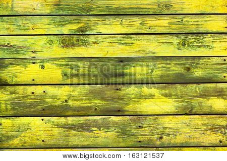 Aged plank yellow. The texture of natural wood. Vintage bright background. Grunge style